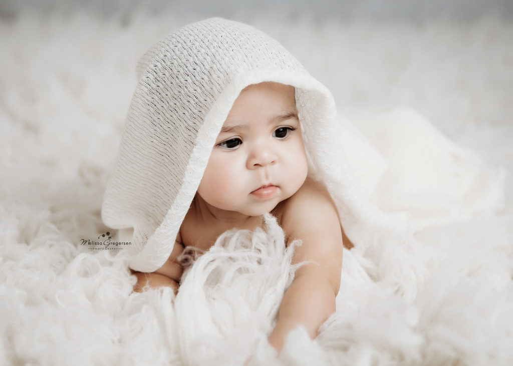 baby in white blanket and fur at Gregersen Photography Studio in Kalamazoo, MI